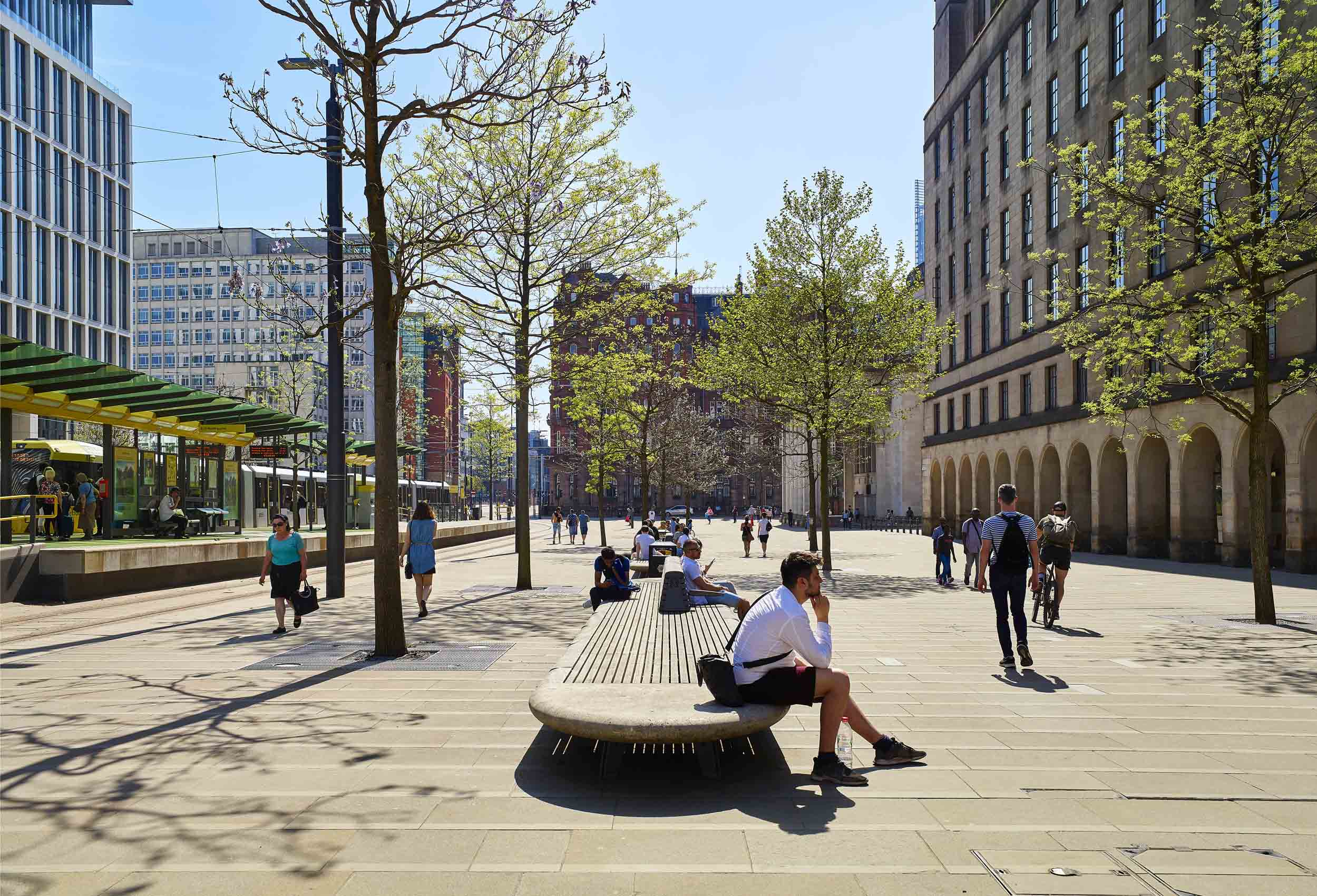 man on bench in St Peters Square Manchester by Gillespies Architects