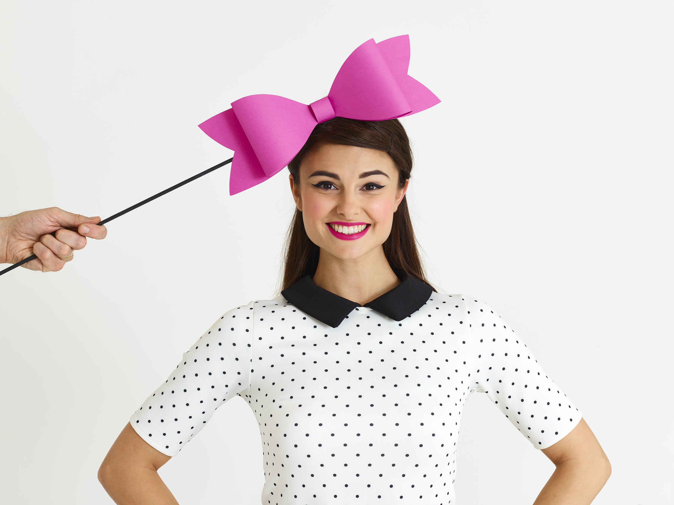 woman with a big pink bow above her head